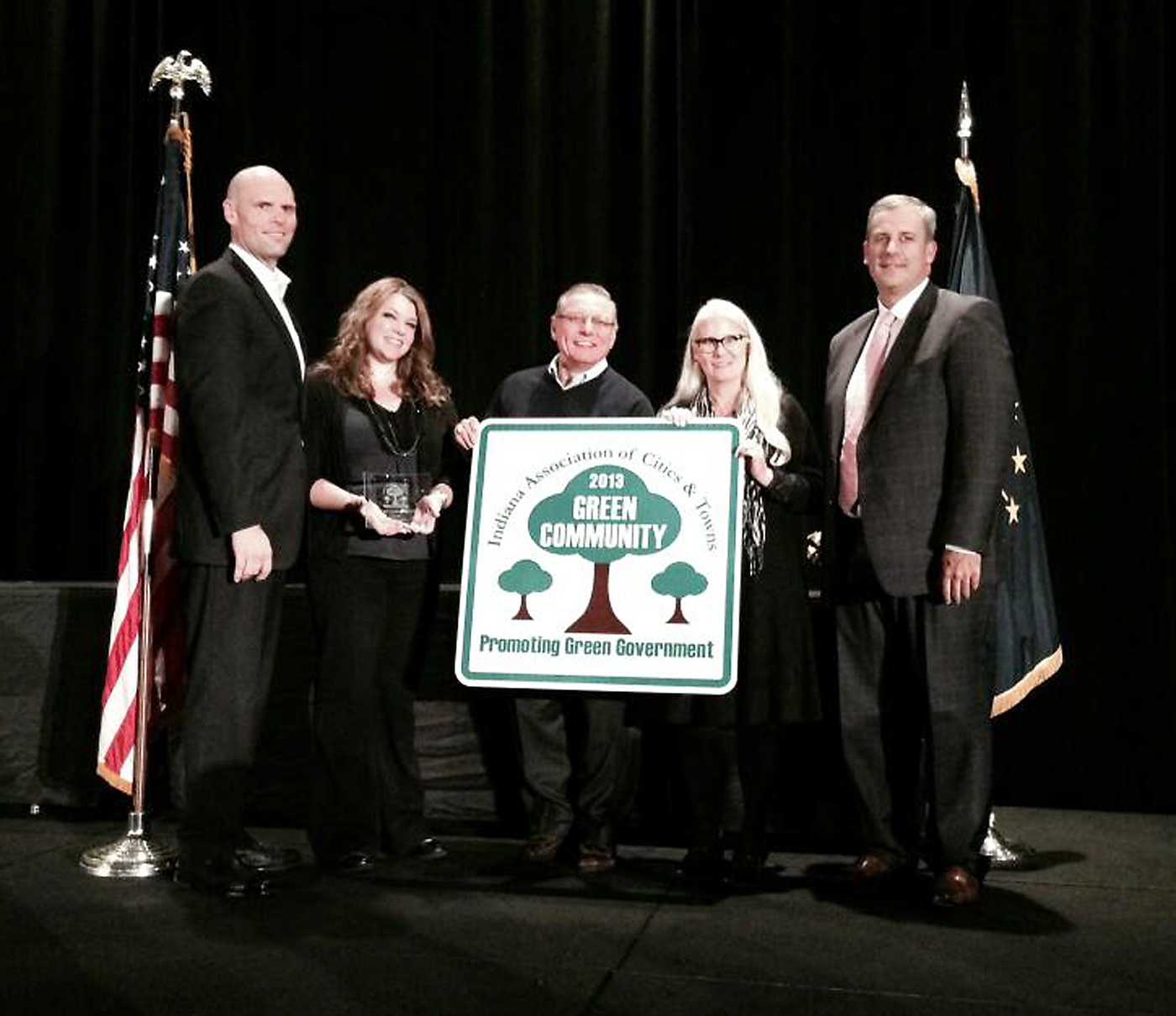 From left: Deputy Mayor Todd Burtron, Teresa Evans of Westfield's Communications Dept., City Council President Jim Ake, Parks and Recreation Director Melody Jones and IACT Executive Director Matt Greller. Indiana Association of Cities and Towns hold the city's Green Community of the Year award. (Submitted photo)