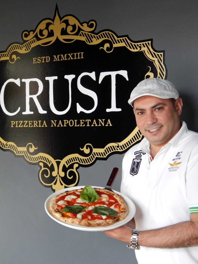 Chef/Owner Mohey Osman with his signature Margherita pizza. (Photo by Karen Kennedy)