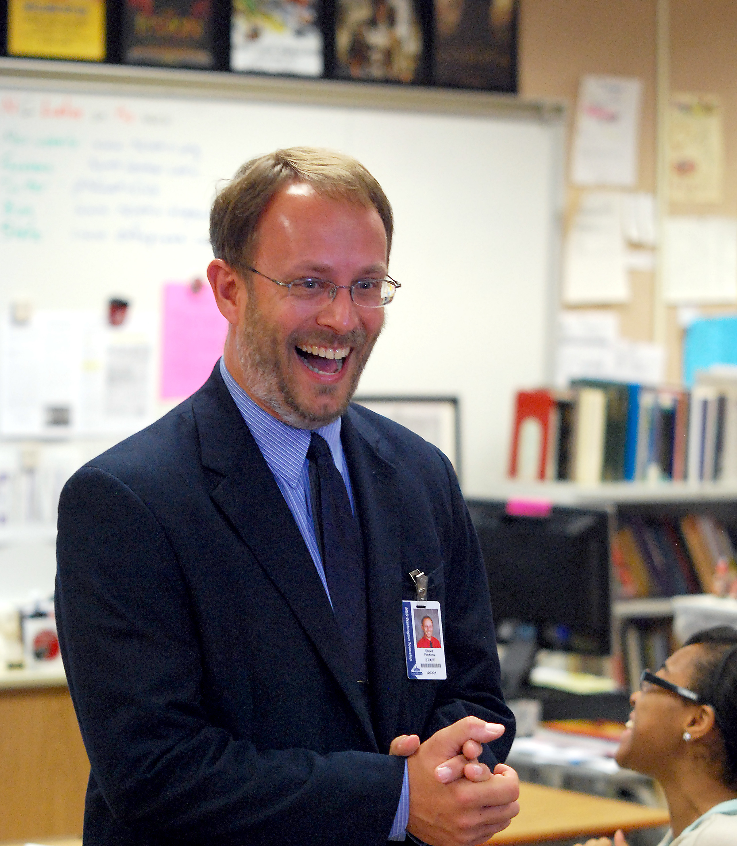 Steve Perkins gets the surprise of a lifetime as his Latin class is disrupted with the announcement of him winning Indiana Teacher of the Year on Oct. 4. (Photo by Robert Herrington)