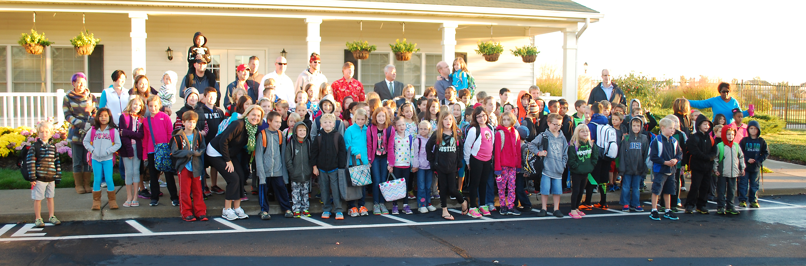 Students, parents and family members gathered at the Countryside Clubhouse for a group picture before walking to school. (Photos by Robert Herrington)