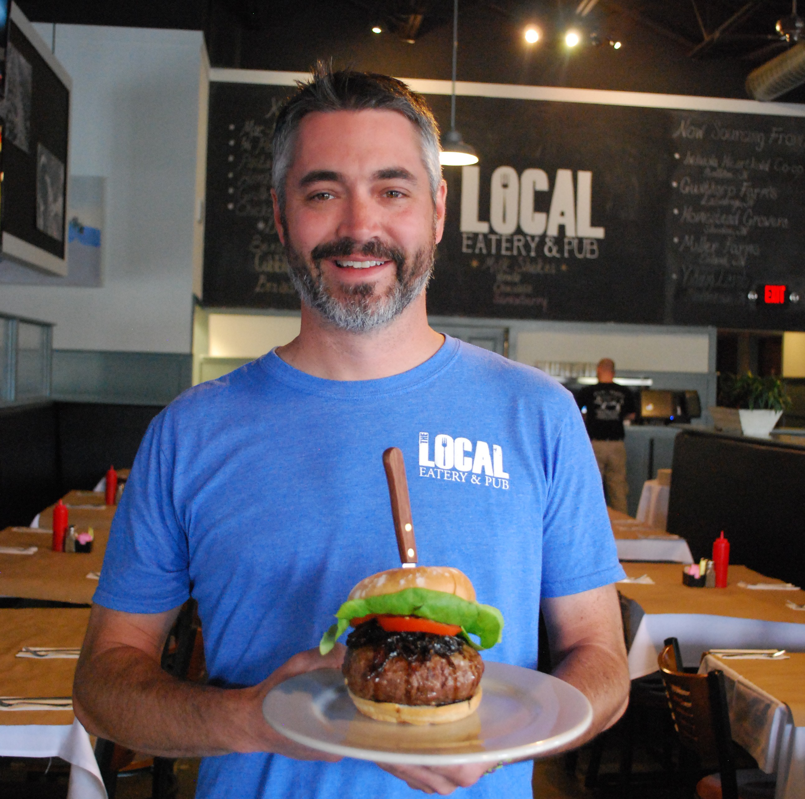 Local Eatery and Pub Executive Chef Craig Baker displays the entry that is sending him to the World Burger Championship in Las Vegas. (Photo by Robert Herrington)