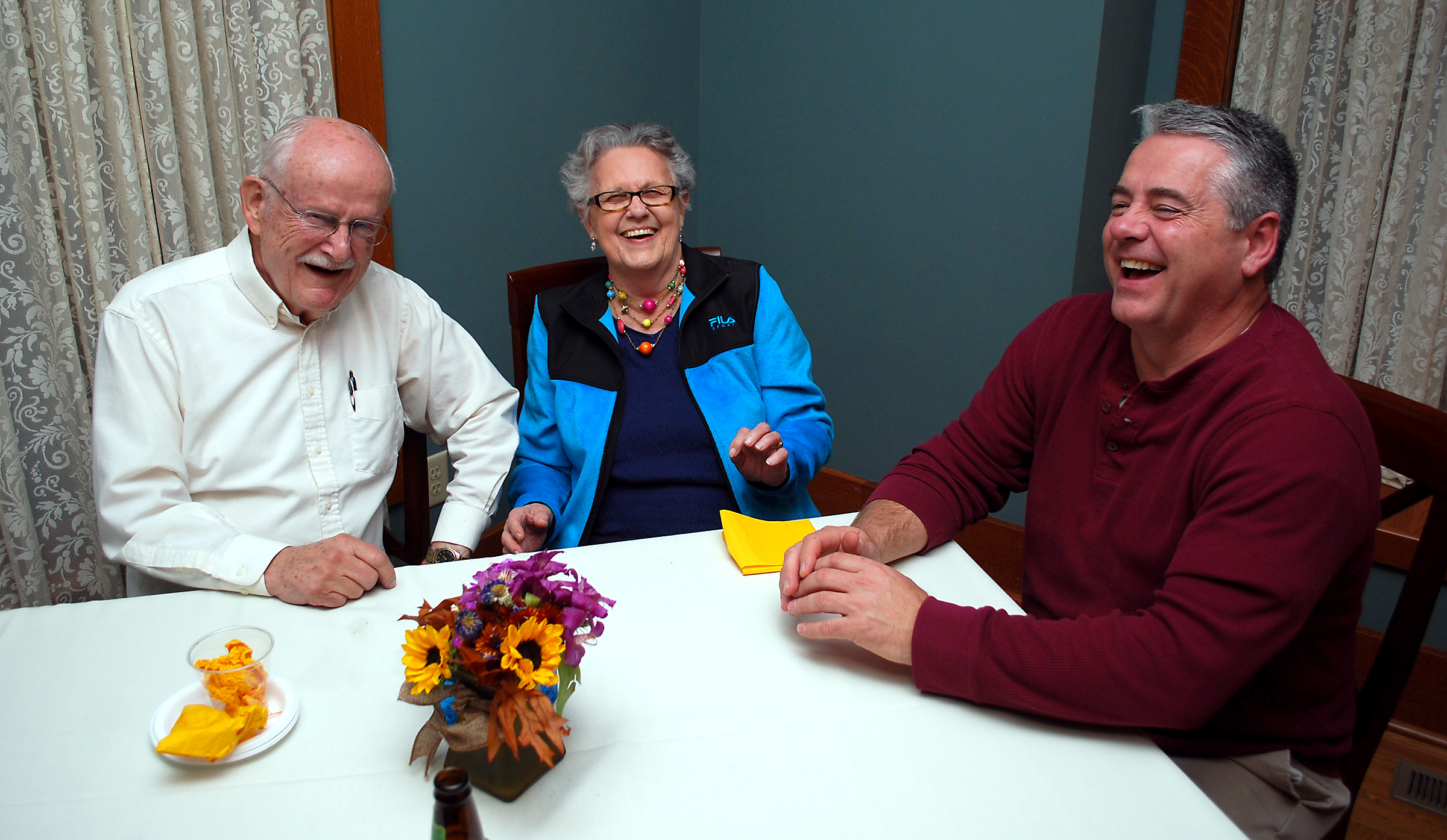 From left: Jim Harvey, Betty Otis and Pat Callahan share a laugh at The Fern, which Callahan owns.