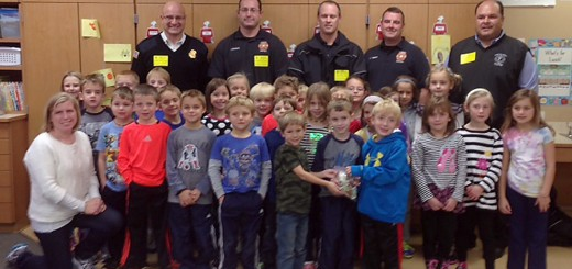 "Students in Krista Beck's first grade class at Geist Elementary School came together and donated their loose change to help raise funds for the Hamilton County Fallen Firefighters Memorial. After all the pennies, nickels, dimes and quarters were counted the first-graders donated $150 to the project.  ""It was tremendous,"" Local 4416 President Tony Murray said. ""It's a really nice gesture.""  The Memorial Committee was grateful for the students' hard work and wanted to find a special way to show their appreciation. In addition to the visit by the firefighters, the class also will receive a brick paver that will be displayed at the memorial sight.  ""They can visit and find their brick years from now,"" Murray said.  Beck said this project has helped students remember the sacrifice firefighters make for their communities and remind them that they are never too young to help others.  Local career and volunteer firefighters have come together as a committee to construct a memorial for three Hamilton County firefighters who gave their life in the line of duty. The goal is to raise $275,000 to build the monument on the grounds of the Hamilton County Judicial Center in Noblesville by September.   Murray said small and large donations have been made – a total of approximately $20,000 since the Oct. 13 campaign kick-off.  ""A lot of interest generated is from Current's participation,"" he said. ""The word is getting out… We've applied for some grants. We're on our way.""  Glen Schwartz and his family donated $12,000 at the kick-off announcement.  ""For us it's a very ambitious project. We've received support verbally and $20,000 in the span of a few weeks. I'm very happy with the public support,"" Murray said.  Murray said the first milestone is raising $30,000 for the down payment on the bronze statue of a grieving firefighter by Arizona sculptor Nicholas Wilson. The statue will include three bronze helmets to honor the three firefighters who died in the line of duty. In the event that another emergency worker dies tragically, another helmet will be placed.  Murray said the ""100 percent original piece"" takes several months to create. The park-like setting of the memorial is designed by Hittle Landscaping and includes two key items: a piece of metal beam from the World Trade Center in New York City and the sculpture."