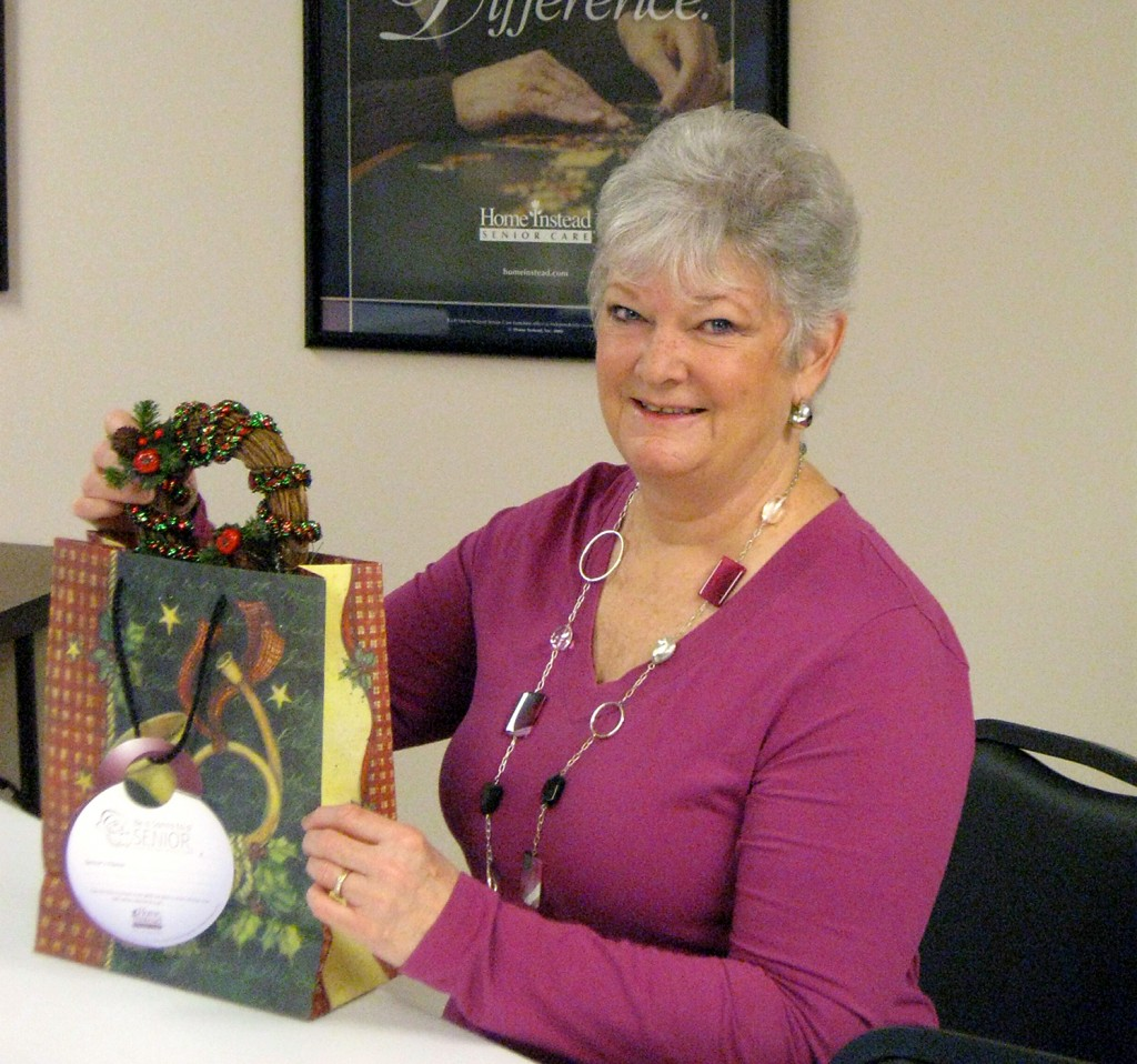 Linda Connors helps Home Instead Senior Care get a jump start on wrapping the gifts for seniors. (Submitted photo)