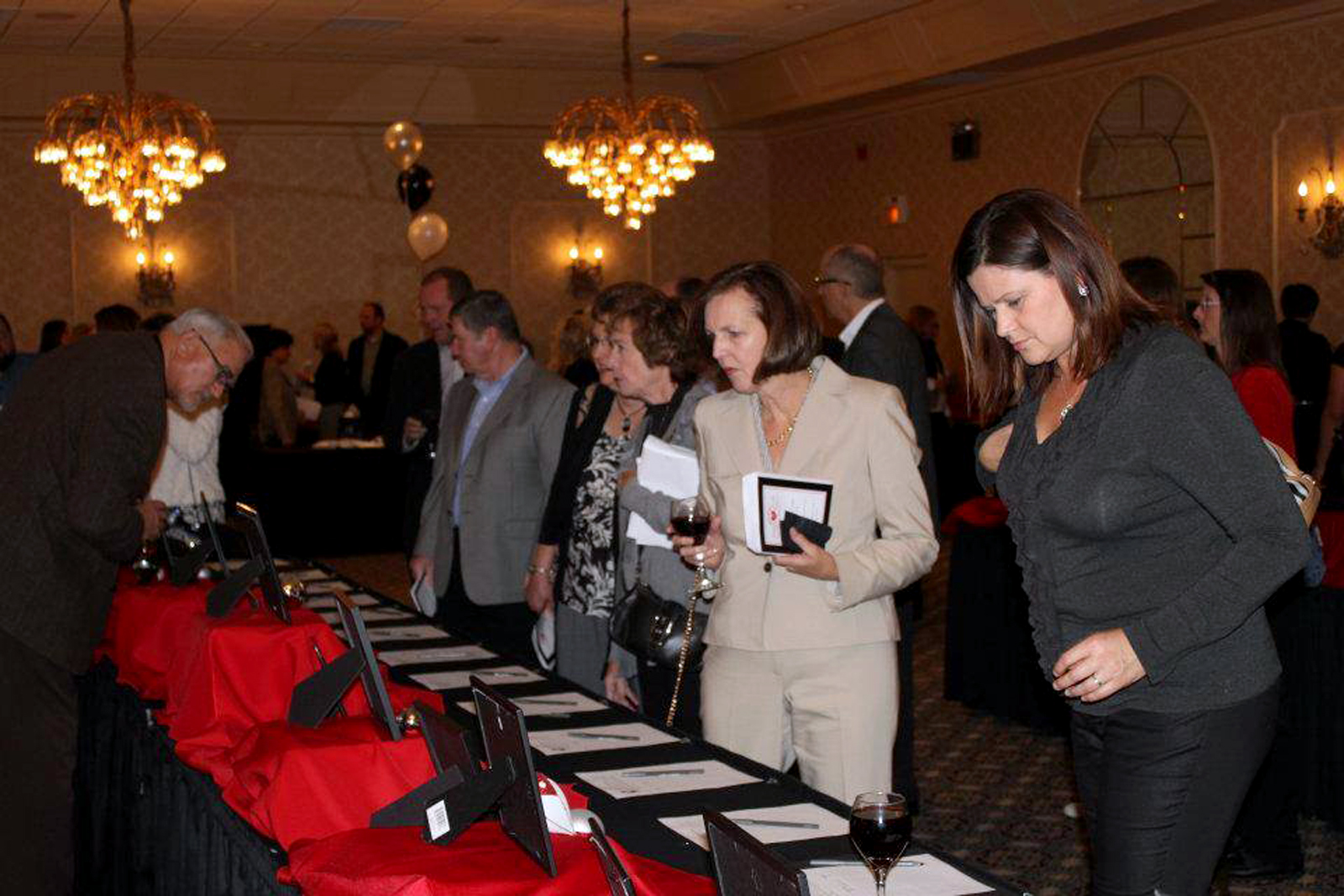 Guests of last year's Tinsel & Tails Holiday Petacular take a look at the various silent auction items. This year's event is 6 to 10 p.m. Nov. 21 at Ritz Charles in Carmel. (Submitted photo.)