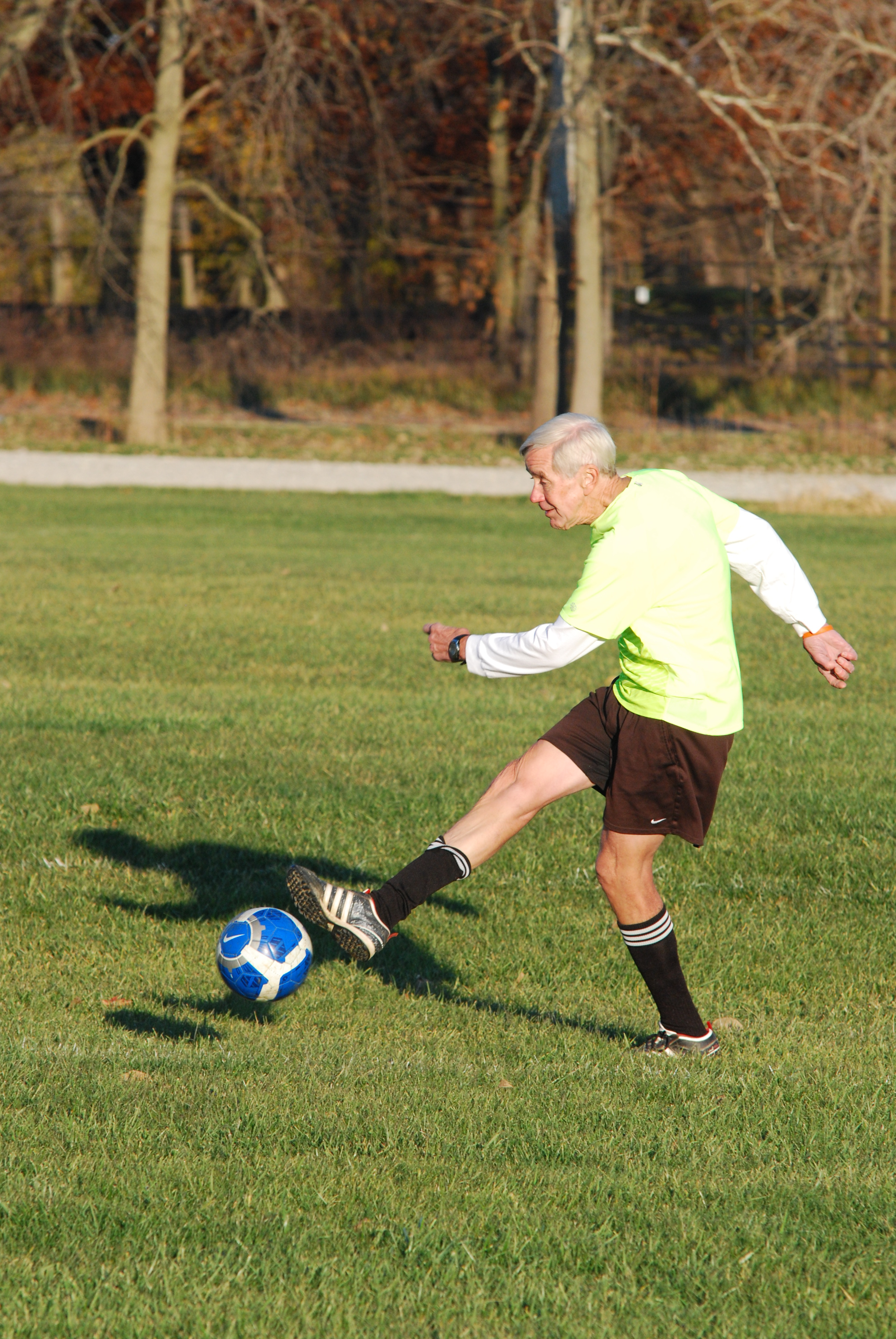 Bruce Carlstedt practices with members of his adult coed soccer team at Habig Fields. Carlstedt helped to found Westfield Youth Soccer and started the adult recreation league. (Photo by Robert Herrington)