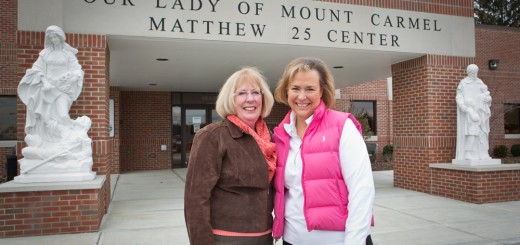 Maggie Charnowski, left, and Jayne Slaton manage Our Lady of Mount Carmel's chari- table services that benefit Carmel's needi- est residents. (Photo by Sara Crawford)