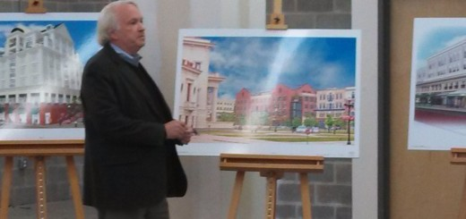 Pedcor CEO Bruce Cordingley unveils the latest renderings of new buildings planned for City Center. (Staff photo)