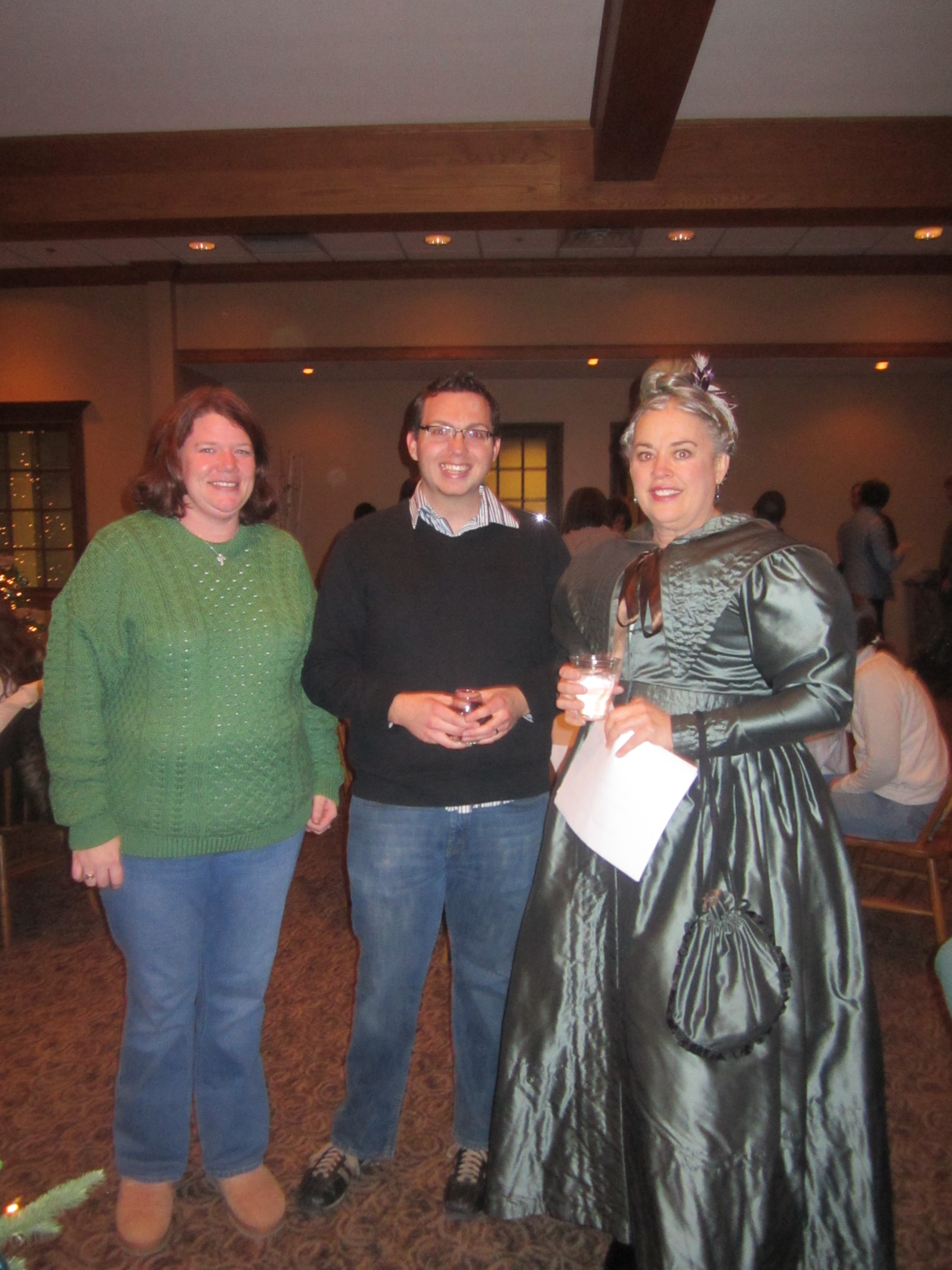 Guests, including Meghan Flagel and Scott Bardash, attended Holiday Cheer and visited with volunteers from the 19th century, including Susie Alexander.