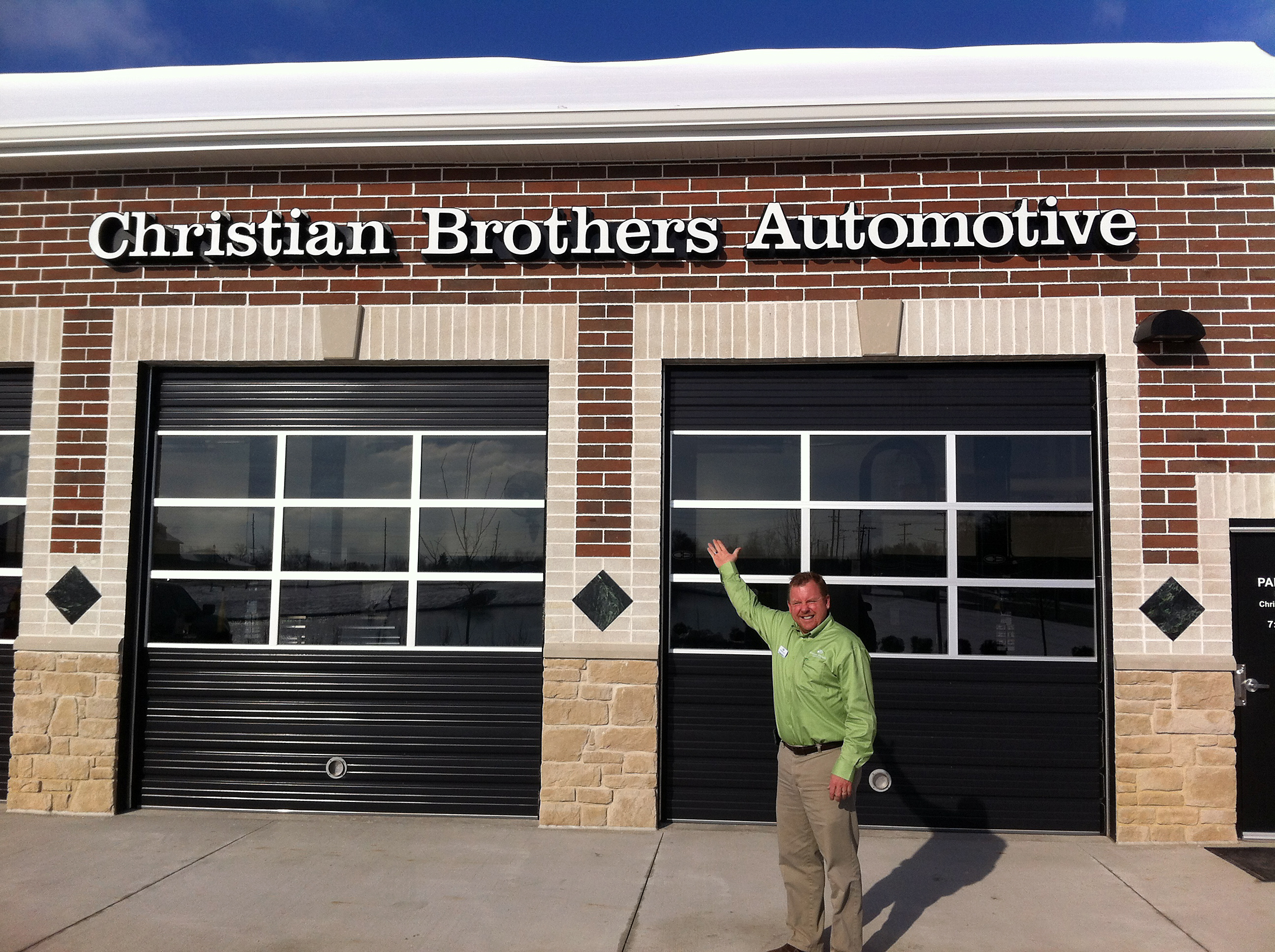 Russ Miller opened the doors of Christian Brothers Automotive, 14807 N. Gray Rd., on Dec. 3. (Photo by Ron Hermann.)