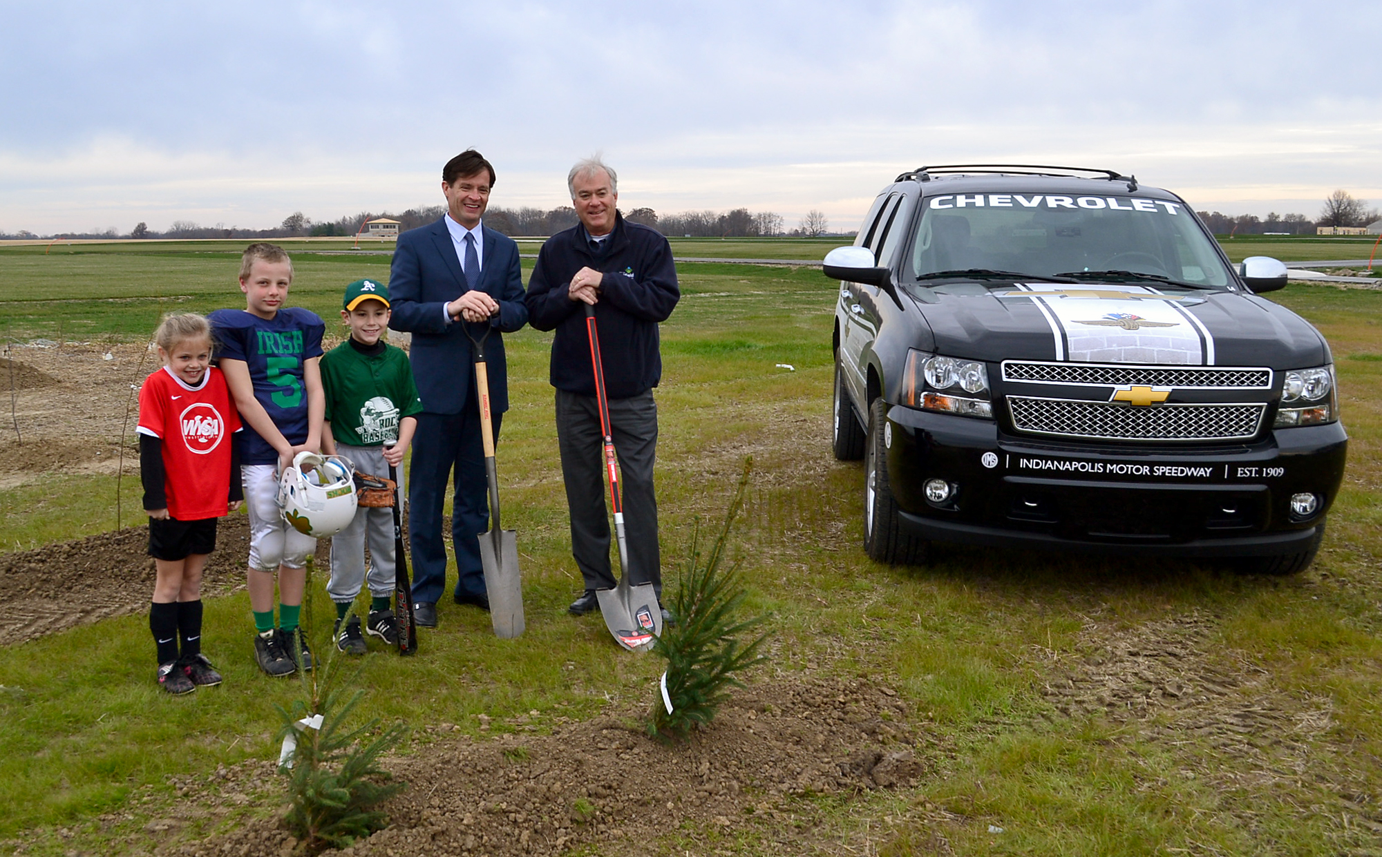 Players from Westfield Youth Soccer Association and Westfield Youth Sports Incorporated join IMS President Doug Boles and Westfield Mayor Andy Cook for the planting of trees at Grand Park. (Submitted photo)