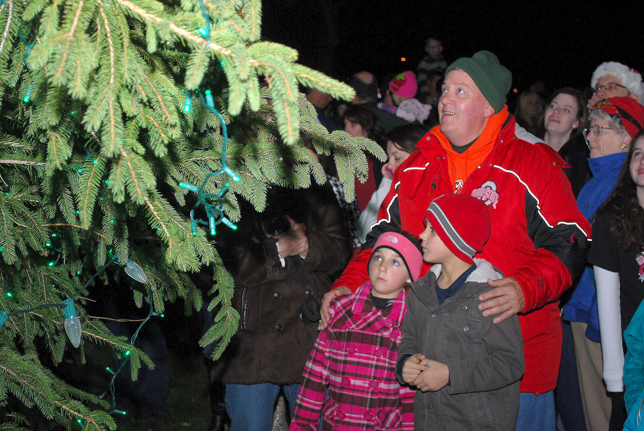 Larry Mileski looks at the Westfield Christmas Tree with his grandchildren, Olivia and Trenton Mileski, at last year's tree lighting. (Photo by Robert Herrington)
