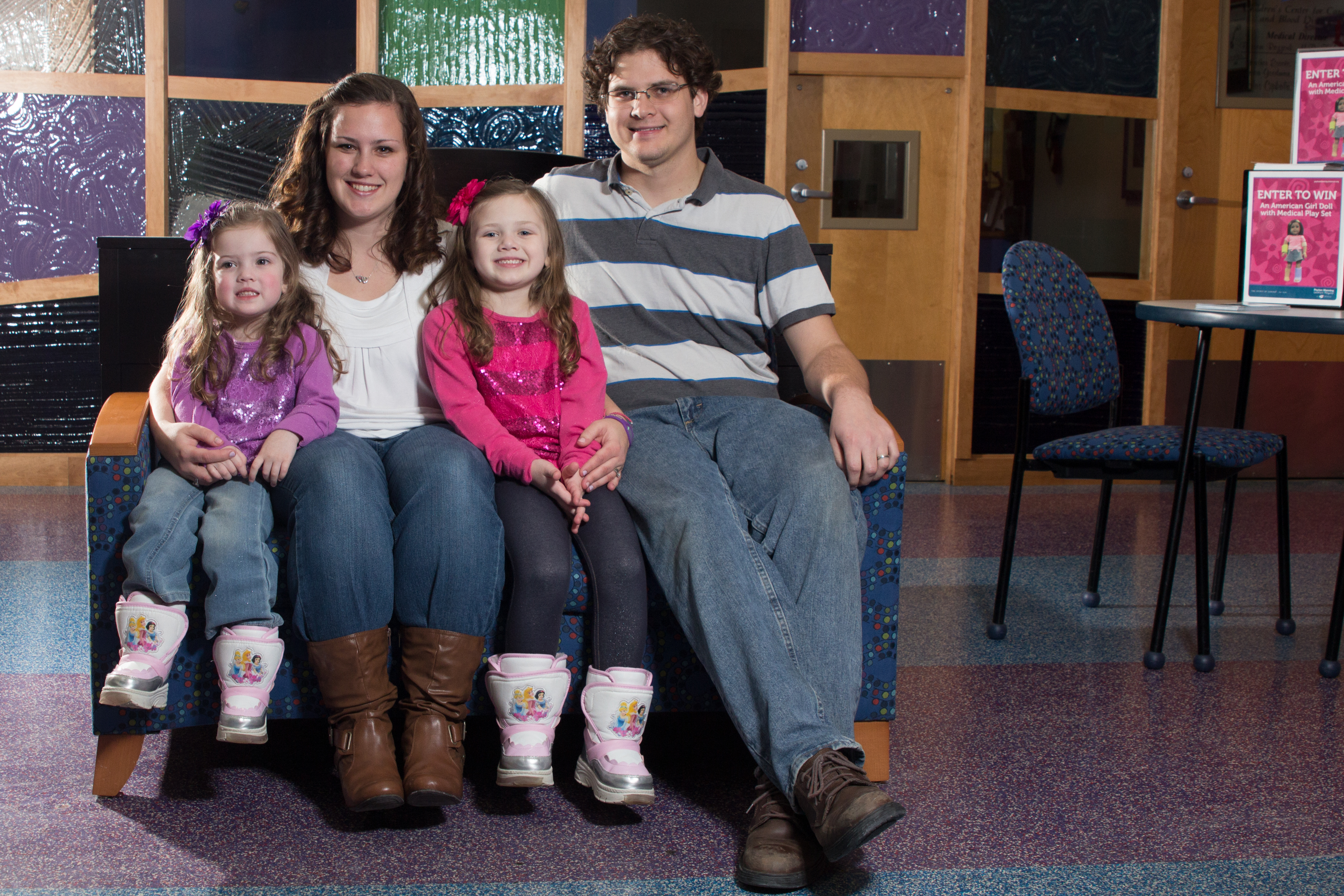 From left, Ally, Courtney, Ellie and John Cooley are a family that helps others. Courtney's daughters have been treated at St.Vincent Peyton Manning Children's Hospital and wish to give back to other children.