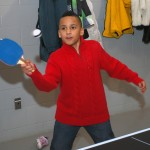Malik Edwards plays ping pong with his mother, Rashunda.