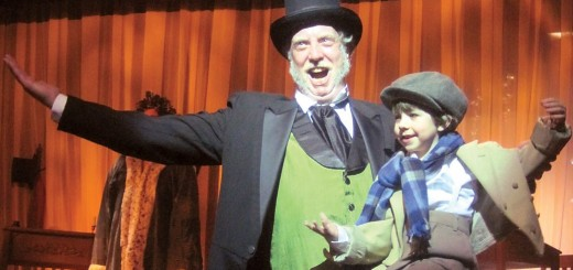 Ebenezer Scrooge (Jeff Stockberger) celebrates Christmas with Tiny Tim (6-year-old Sage Barber Murrell) Beef & Boards Dinner Theatre's current production of Charles Dickens' A Christmas Carol. (Submitted photo)