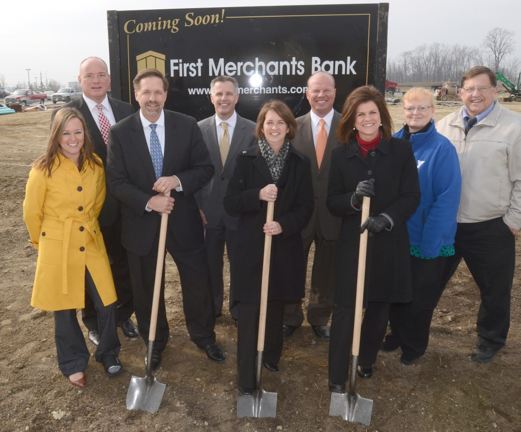 From left: Lindsay Sweet, Mike Stewart, Mike Hurst, Jeff Davis, Tammi Reichert, Troy Galbraith, Christine Alfery, Karla Hanger and Kevin Scharnowske broke ground on the new First Merchants Bank on Michigan Road. (Submitted photo)