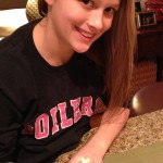 Celia Simmonds, 11, works to create rubber band bracelets to share with children in Haiti. (Submitted photo)