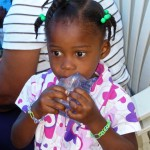 A little girl in Haiti wears a rubber band bracelet that was made by Celia Simmonds of Carmel. (Submitted photo)