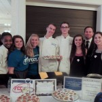 "Carmel High School students from the ""Baking for a Difference"" program, from left, Gabbey Price, Maddie Troy, Katie Ingersoll, Taylor Farmer, Justin Burnett, Molly Frank, Supt. Nicholas Wahl and Abby Frank. More photos from the event are available at www.currentincarmel.com. (Staff photos)"