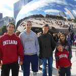 From left, Bailey Inman, Andrew Inman, Jochen Schade, Mary Grace Inman and Rowan Inman pause in front of The Bean in Chicago's Millennium Park.