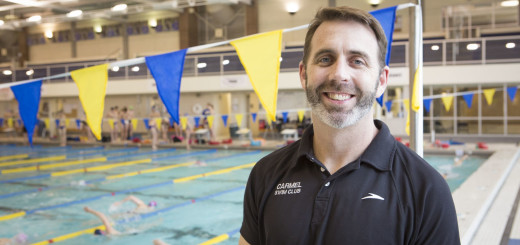 Carmel girls swim team head coach Chris Plumb is hoping to gain a record- setting 28th consecutive state champi- onship. (Photo by Sara Crawford)