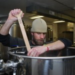Brew Master Luke Kazmierski stirs the mash as he brews.