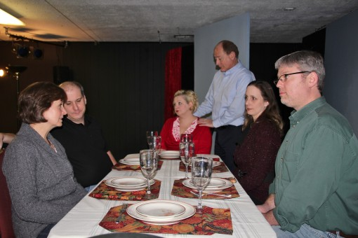 """A family helps its aging mother through Thanksgiving dinner in a scene from """"The Dining Room."""" From left, actors Barb Weaver, Ryan Shelton, Sonja Distefano, Mark Tumey, Tonya Fenimore and Daniel Shock (submitted photo)"""