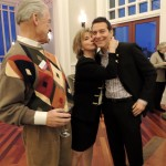 Dr. Pamela Steed (center) embraces Michael Feinstein as Dick Rollin looks on. (Staff photo by Tonya Burton)