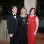 From left, Indy Car driver Ed Carpenter and his wife Heather Carpenter pose with Tracy Miller during a gala held at the Lucas Estate. (Staff photo by Tonya Burton)