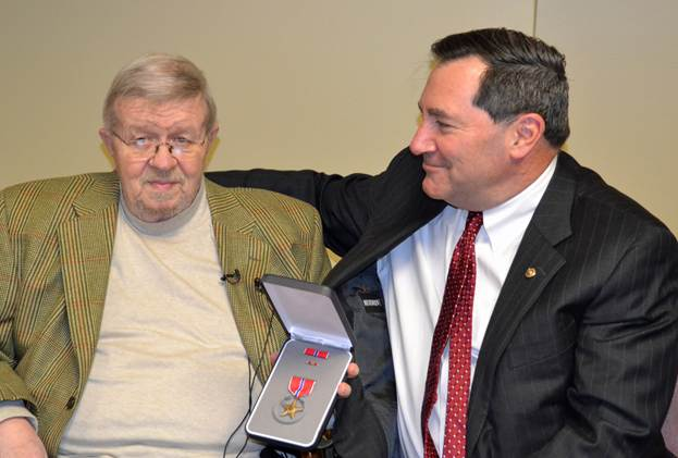 U.S. Sen. Joe Donnelly presents the Bronze Star Medal to veteran Michael Hodgson.