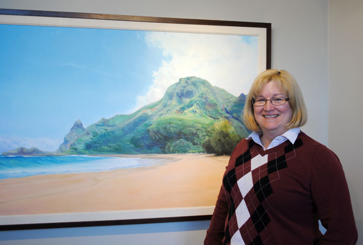 Catherine Charter Bauder allows people to watch her paint during her gallery hours at Inspire Gallery at 15 E. Main St. in Carmel. (Staff photo)