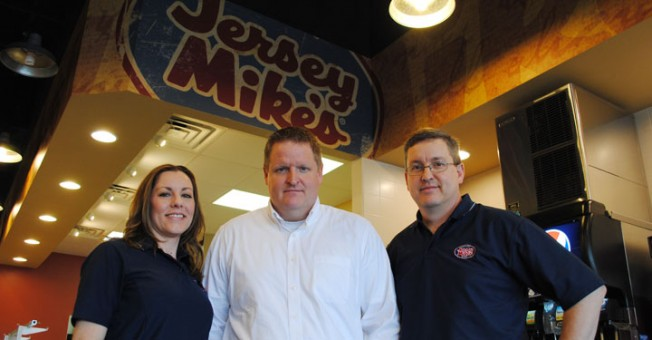 The co-owners of the new Jersey Mike's Subs restaurant in Carmel, from left, Liz, Casey and Greg Watson hope to open two more restaurants in the area within the next year. (Staff photo)