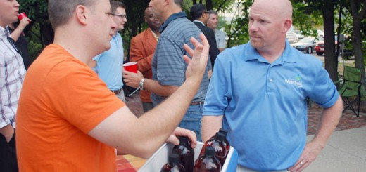 "Brewer Brian Graham of Four Day Ray, left, talks with Kenneth Alexander, Westfield's public works director, while dispensing samples of his beer during the Downtown Westfield Association's ""Party on the Patio"" on Sept. 18. (file photo by Robert Herrington)"