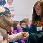 Mohawk Trails Elementary second-grader Lily Franciosi pets a baby chick held by 4-H'er Kaylee Dugger.