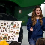 Fishers High School's Kayleigh Crane explains the mini 4-H program, which is available to first and second grade students.