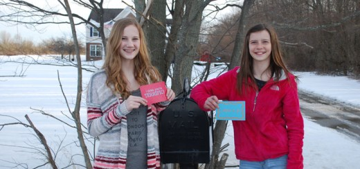 Lindsay, left, and Emma Severson cre- ated Positive Postcards after receiving mail for their good report cards. (Photo by Robert Herrington)