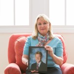 Dawn Finbloom holds her son's senior portrait. (Photo by Sara Crawford)