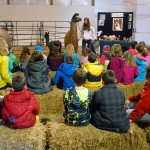 A second grade classroom from Hinkle Creek Elementary listens to the presentation on llamas from 4-H'ers Lily Arnold and Abby Dugger.
