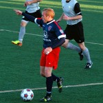 Indy Eleven defender Kyle Hyland directs his teammates before passing the ball.