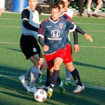 Indy Eleven forward Pedro Mendes dribbles up the field through Tourbeau defenders. Mendes had both of the team's goals in the 2-0 win.
