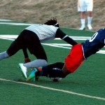 Indy Eleven midfielder Walter Ramirez gets knocked to the ground by Tourbeau forward Mohammed Dumbuya.