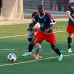 After getting past a Tourbeau player, Indy Eleven midfielder Don Smart looks for an opening or teammate to pass to.