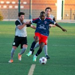 Indy Eleven midfielder Don Smart attempts to dribble past two Tourbeau players.