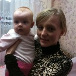 Alina holds up her baby. She is just one of the young moms struggling inside the Ukraine. Photo by Amy Sorrells.