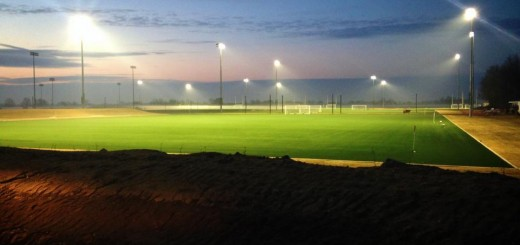 Lights shine on an artificial field as the sun rises above Grand Park. (Submitted photo)