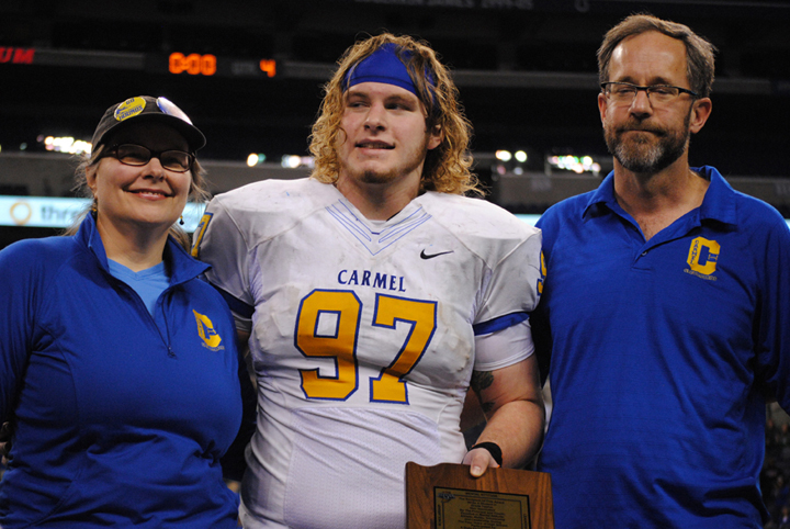 Carmel senior Vic Roe, center, won the Indiana High School Athletic Association Phil N. Eskew Mental Attitude Award after the 2013 6A championship game. (Staff photo)