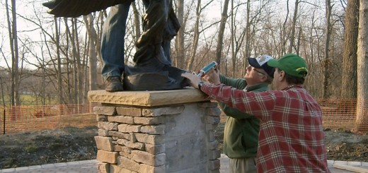 Gary Warren, Bill Eagleson and Randy Neff install the bronze Angel of Hope statue on her pedestal in No- blesville's Forest Park. The memorial will be dedicated at 3 p.m. May 4. (Submitted photo)