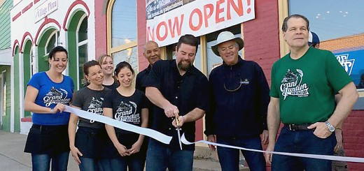 Co-owner Jon Knight cuts the ribbon officially opening Grand Junction Brewing Co. on April 19 with Mayor Andy Cook and co-owner Charlie Wood beside him.