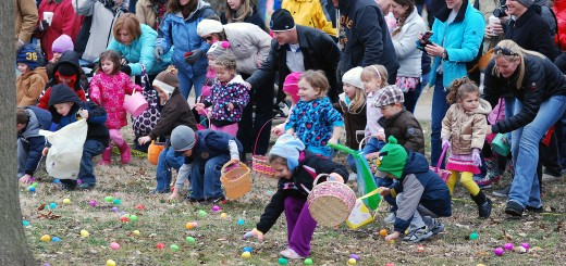 Children race onto the open area of Forest Park during last year's Easter Egg Hunt. (File photo)