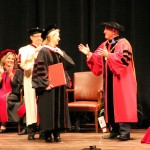IU President McRobbie, right, congratulates actress Meryl Streep on receiving an honorary degree. From left, Carmel resident, MaryEllen K. Bishop, Vice Chair; and Mikel G. Tiller, University Grand Marshall, look on. (Staff photo by Anelena Ackerly)